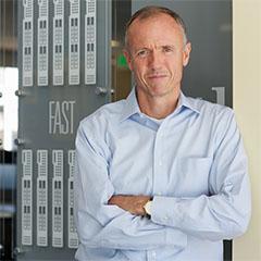Tom Gillis, SVP/GM de redes y seguridad BU